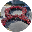 Gilead employees form a red ribbon