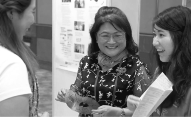 Alice Chan, the CEO of The Society for AIDS Care Hong Kong, joins an employee to discuss the program. Image links to feature story 'Supporting Local Communities in the Asia Pacific Region.'